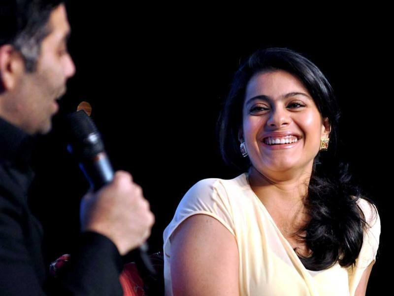 Kajol laughs at the Ficci Frames 2013 Annual Conclave of the media and entertainment industry in Mumbai on March 14, 2013. (AFP Photo)