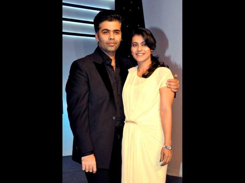 Kajol Devgan and film director Karan Johar (R) pose for a photo at the Ficci Frames 2013 Annual Conclave of the media and entertainment industry on March 14, 2013. (AFP Photo)