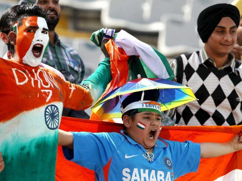 Supporters cheer for the Indian team during the second day of the 3rd Test match against Australia at PCA Stadium in Mohali. (PTI)