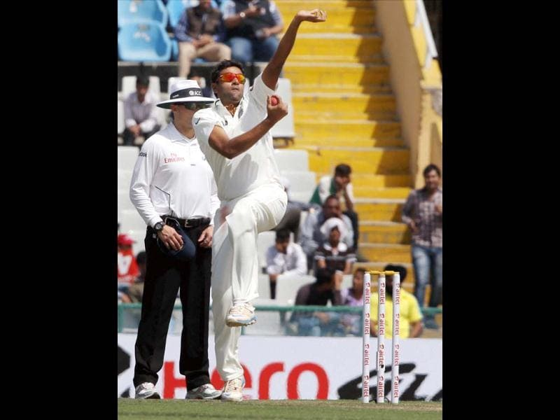 R Ashwin bowls during the second day of the 3rd Test match against Australia at PCA Stadium in Mohali. (PTI)