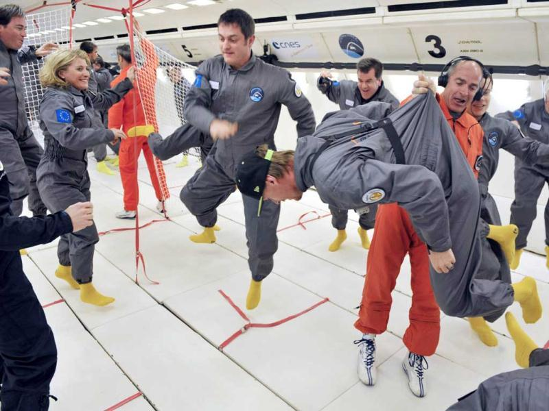 Civilian passengers of the Airbus A330 Zero-G enjoy the weightlessness during the first zero gravity flight for paying passengers in Europe. (AFP)