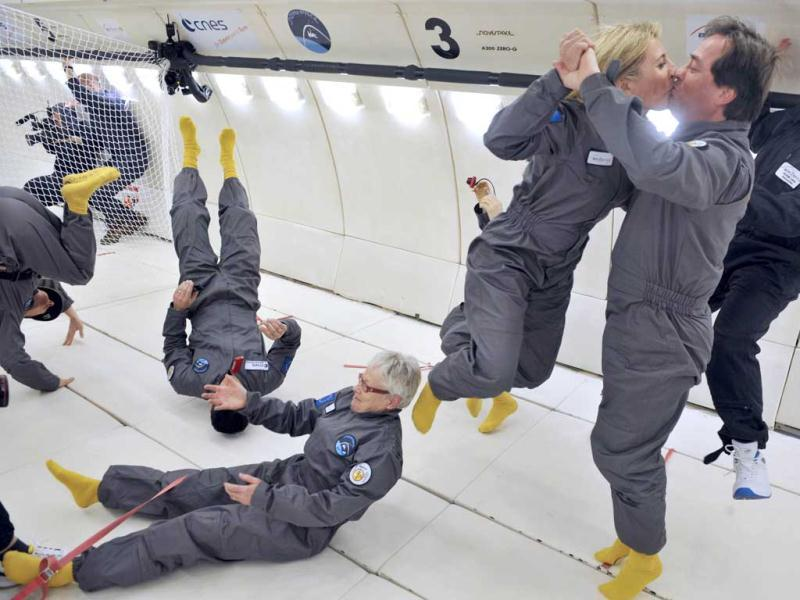 Civilian passengers of the Airbus A330 Zero-G enjoy the weightlessness during the first zero gravity flight for paying passengers in Europe. All boarding cards, costing 6,000 euros, were sold for the years 2013 and 2014. (AFP)