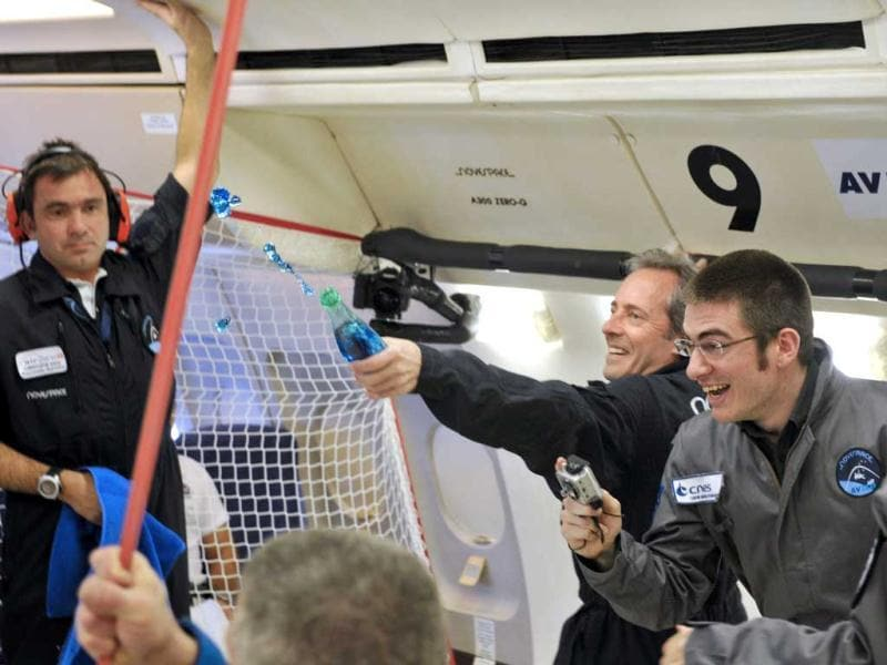 A man throws water as civilian passengers of the Airbus A330 Zero-G, who are not astronauts nor scientists, enjoy the weightlessness during the first zero gravity flight for paying passengers in Europe. (AFP)