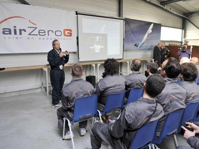 Civilian passengers of the Airbus A330 Zero-G listen to the President of Novespace Jean-Francois Clervoy (C) during a preparation meeting at the headquarters of Novespace near the airport in Merignac in Europe. (AFP)