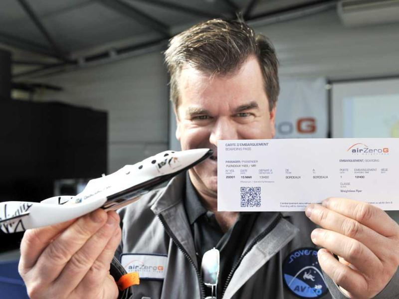 Yves Pleindoux, one of the civilian passengers of the Airbus A330 Zero-G, who are not astronauts nor scientists, poses with his boarding pass at the headquarters of Novespace near the airport in Merignac, before the first zero gravity flight for paying passengers in Europe. (AFP)