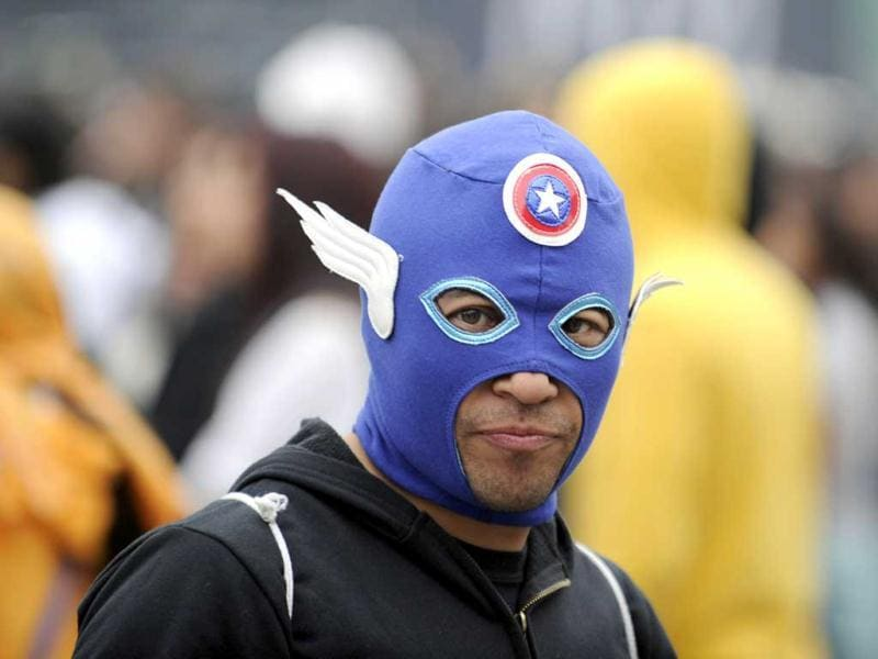A fan wears a mask during the first day of the Vive Latino 2013 Music Fest at the Foro Sol in Mexico City. (AFP Photo)