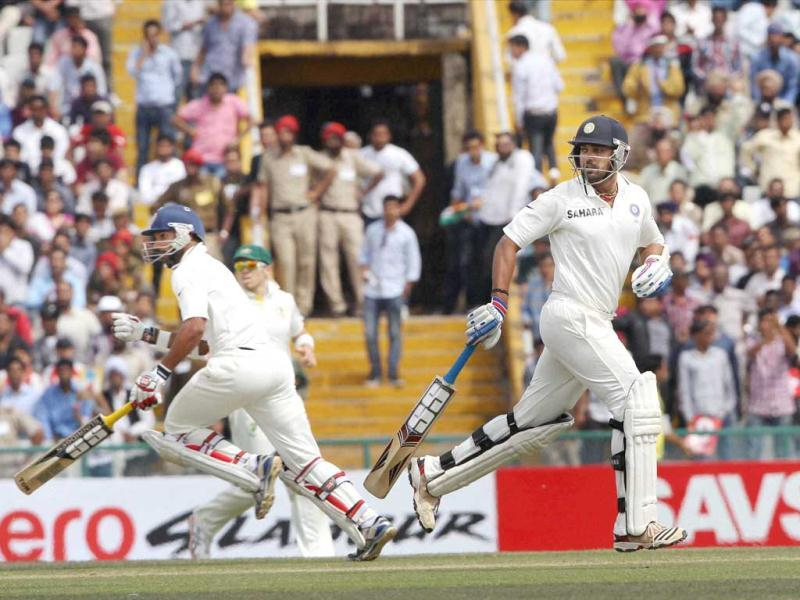 Shikhar Dhwan and Murli Vijay run between the wickets during the third day of the 3rd Test match against Australia in Mohali . PTI Photo