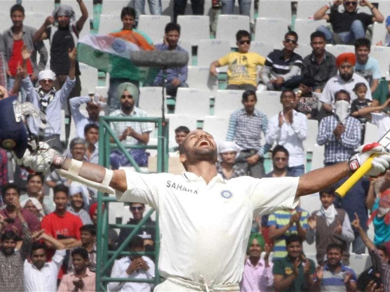 Shikhar Dhwan celebrates his century during the third day of the 3rd Test match against Australia in Mohali . PTI Photo