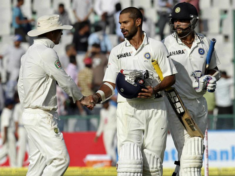 Shikhar Dhawan (C) congratulated by Australian player as he returns pavilion with Murli Vijay after end of play for 3rd day of 3rd Test match at PCA Stadium in Mohali. Gurpreet Singh/HT