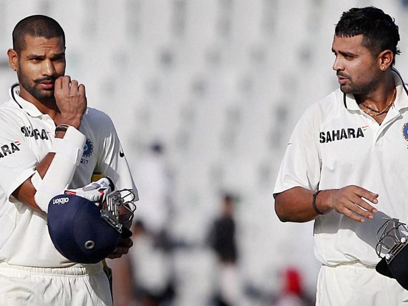 Shikhar Dhawan and Murli Vijay walk off the field at the end of the third day's play of 3rd cricket Test match against Australia in Mohali. (PTI)
