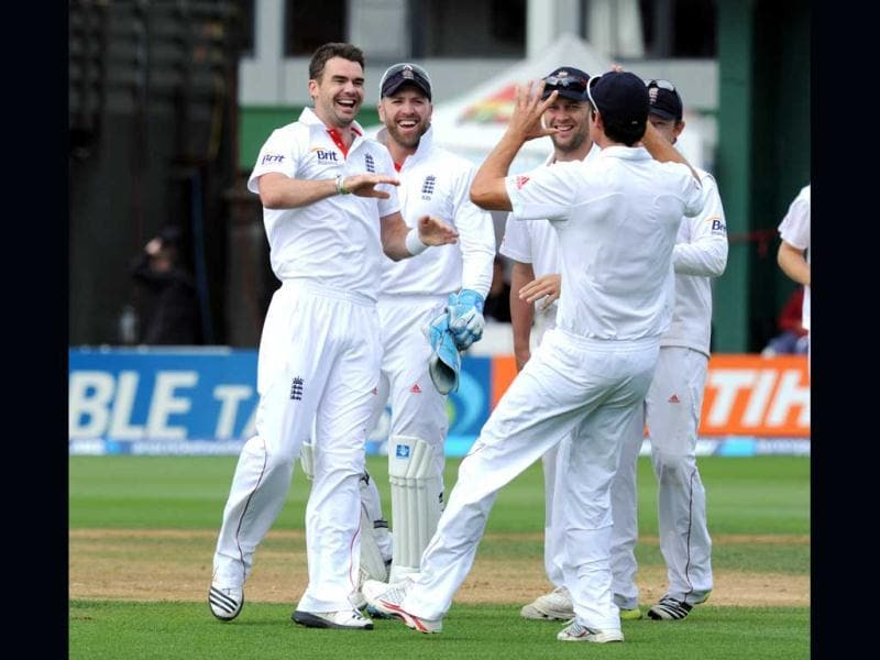 England's James Anderson, left, reacts with captain Alastair Cook after dismissing New Zealand's Peter Fulton for 45 on the fourth day of the 2nd international cricket test, Basin Reserve, Wellington, New Zealand. (AP Photo)