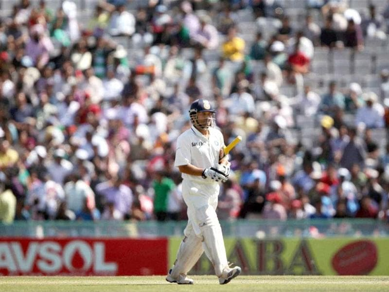 India's Sachin Tendulkar leaves the field after his dismisal on the fourth day of the 3rd Test match against Australia in Mohali. (PTI Photo)