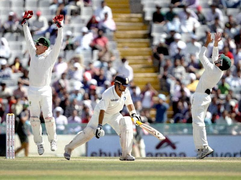 Australian players celebrate the wicket of Sachin Tendulkar on the fourth day of the 3rd Test match against India in Mohali . (PTI Photo)
