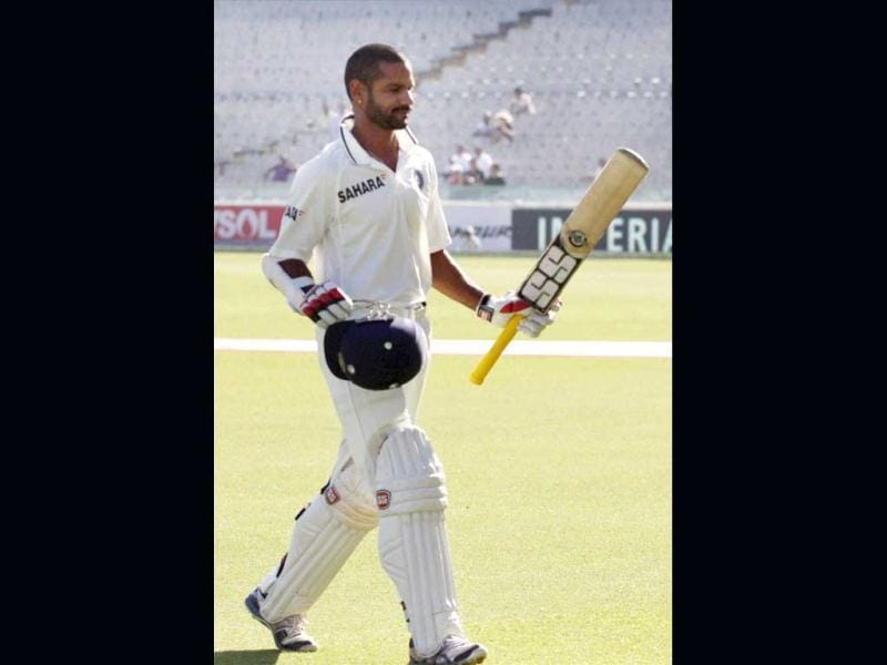 Shikhar Dhawan leaves the field after his dismissal on the fourth day of the 3rd Test match against Australia in Mohali . (PTI Photo)