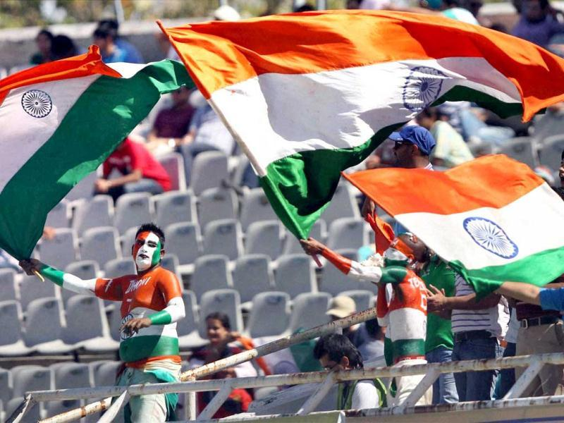 Indian fans cheer for their team during the fourth day of the 3rd Test match against Australia in Mohali . (PTI Photo)
