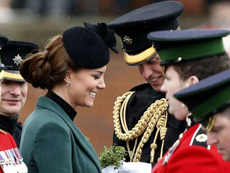 Britain's Duchess of Cambridge Kate, stands with her husband Prince William, before presenting traditional sprigs of shamrock to members of the 1st Battalion Irish Guards at the St Patrick's Day Parade at Mons Barracks in Aldershot, England. AP photo