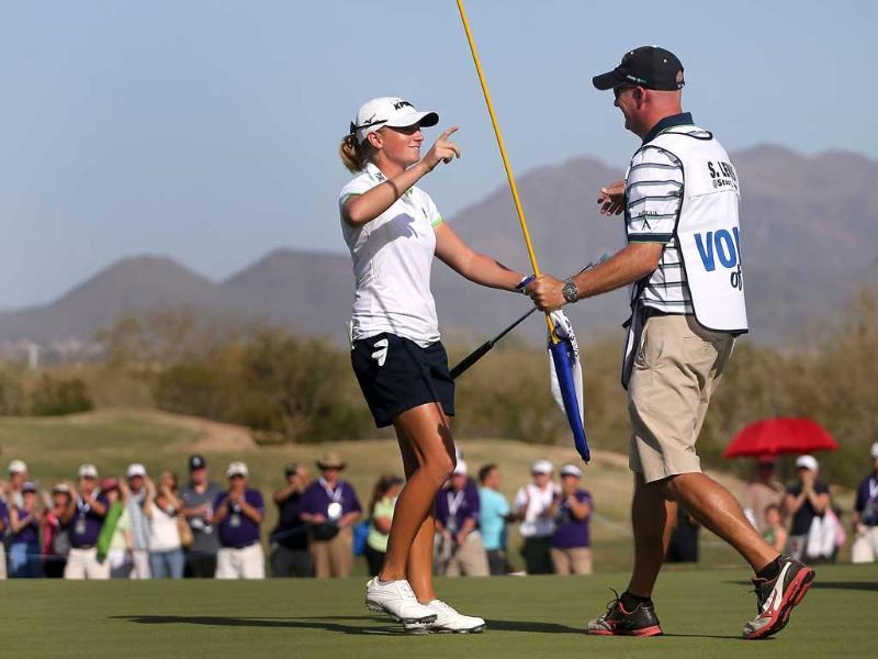 Stacy Lewis hugs her caddie Travis Wilson after winning the RR Donnelley LPGA Founders Cup at Wildfire Golf Club in Phoenix, Arizona. AFP/Christian Petersen/Getty Images