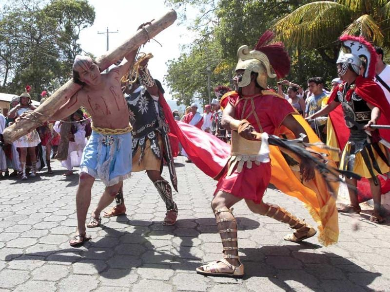 Actors dressed up as Roman soldiers take part in a