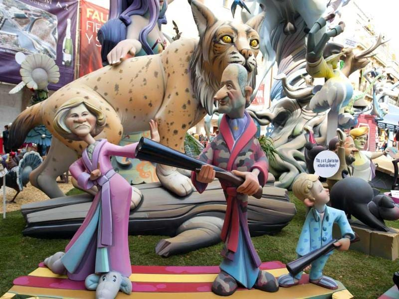 A picture shows a Falla, a gigantic sculpted satirical structure made of cardboard, caricaturing Spain's King Juan Carlos with his wife Queen Sofia during an exhibition for the Fallas Festival, in Valencia. AFP/Jose Jordan