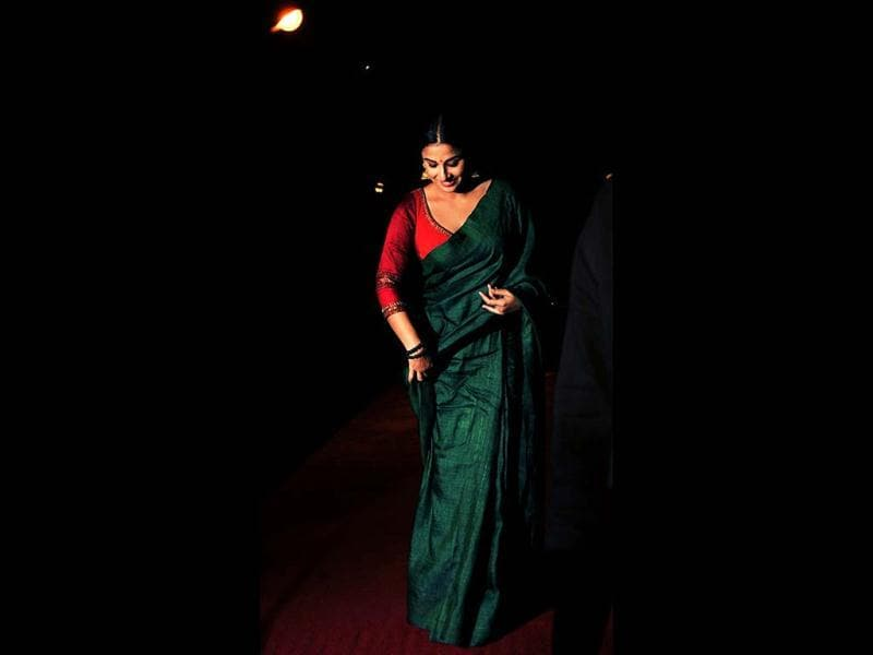 Vidya Balan walks on a red carpet at Bawraas, a live performance event on March 15, 2013. (AFP Photo)
