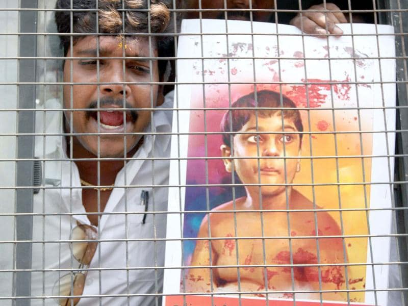 An activist of Students Struggle Committee for Tamil Eelam (SSCTE) shouts slogan from the police vehicle after he courted arrested during the demonstration demanding a United Nations Referendum for Tamil Eelam in Sri Lanka, in Chennai. UNI photo