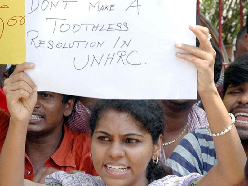 A student holding placard during the demonstration against Sri Lanka for alleged human rights violations of Lankan Tamils at Madras University Campaus, in Chennai. UNI
