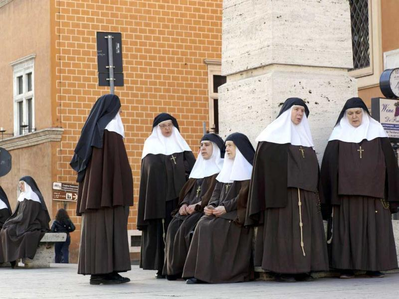 Nuns of the Sisters of the Company of the Cross, from Spain, wait near St Peter's Square for the start of Pope Francis' inaugural mass, in St. Peter's Square at the Vatican. AP Photo