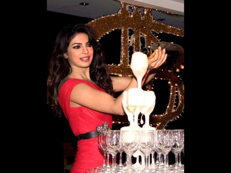Babli Priyanka Chopra pours some bubbly into the glasses. (AFP Photo)