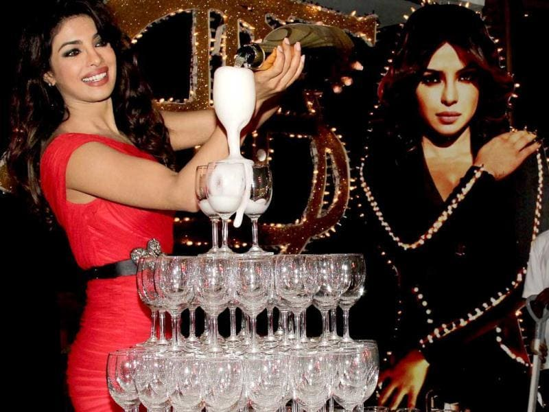 Priyanka Chopra was recently spotted pouring some champagne into a glass pyramid to celebrate her song Babli (or shall we say Bubbly) Badmaash item number for the upcoming film Shootout At Wadala. (AFP Photo)