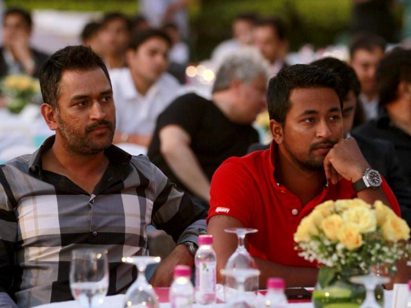 Cricketers MS Dhoni and Pragyan Ojha at the book launch of Yuvraj Singh in New Delhi. Photo by Virendra Singh Gosain/Hindustan Times