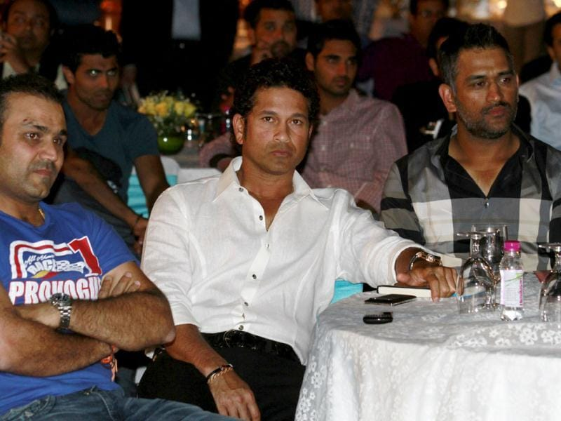 Cricketers Virender Sehwag, Sachin Tendulkar and MS Dhoni at the book launch of Yuvraj Singh in New Delhi. Photo by Virendra Singh Gosain/Hindustan Times