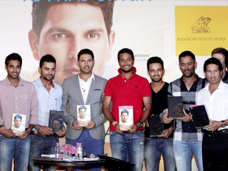 Members of Indian cricket team at the book launch of Yuvraj Singh, The Test of My Life, in New Delhi. PTI Photo by Vijay Verma