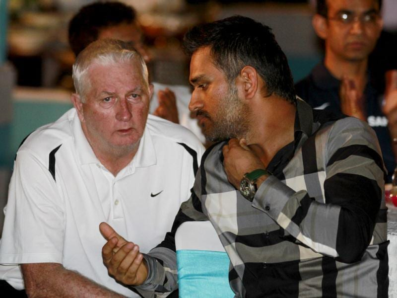 Cricketer MS Dhoni and Indian team coach Duncan Fletcher at the book launch of Yuvraj Singh in New Delhi. Photo by Virendra Singh Gosain/Hindustan Times