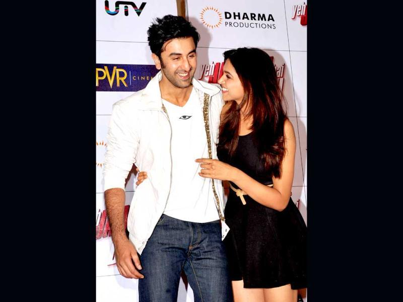 Can't get their arms off each other! Deepika and Ranbir Kapoor at the theatrical launch of Yeh Jawaani Hai Deewani. (AFP Photo)