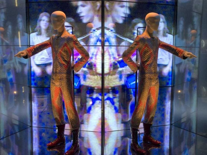 A reflection of the costume that David Bowie wore as Ziggy Stardust on tour and during a performance of 'Starman' on British pop music show Top of The Pops, is photographed as part of a retrospective David Bowie exhibition, entitled David Bowie Is, at the V&A Museum in west London. (AP Photo)