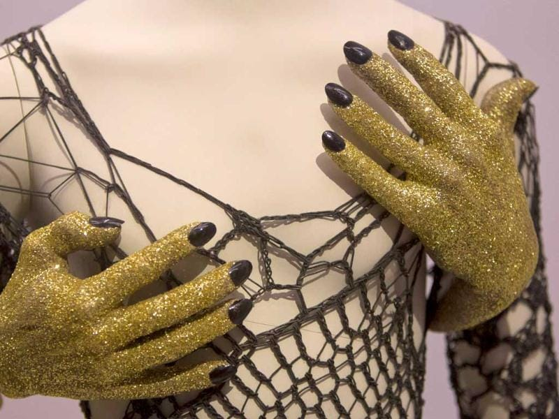 A cobweb costume with fake hands that David Bowie appeared on television with, is photographed as part of a retrospective Bowie exhibition, entitled David Bowie Is, at the V&A Museum in west London. (AP Photo)