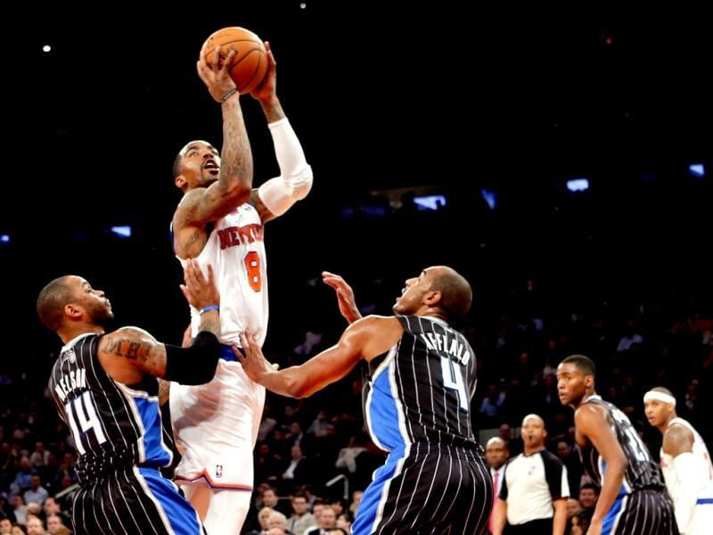 New York Knicks JR Smith shoots over Orlando Magic Jameer Nelson and Arron Afflalo in NBA game in New York. (Reuters)