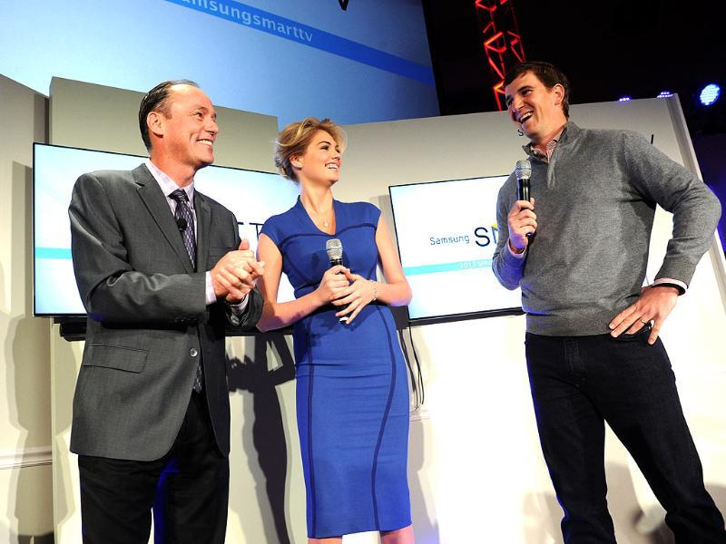 Tim Baxter, left, President, Samsung Electronics America, model Kate Upton and football quarterback Eli Manning showcase the 2013 line of Smart TVs, Wednesday, March 20, 2013, in New York. Photo: Diane Bondareff/Invision for Samsung/AP Images