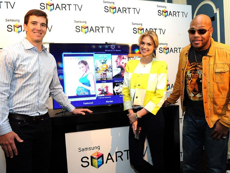 Football quarterback Eli Manning, model Kate Upton and hip-hop artist Flo Rida join Samsung at its launch event for the 2013 line of Smart TVs, Wednesday, March 20, 2013, in New York. Photo: Diane Bondareff/Invision for Samsung/AP Images