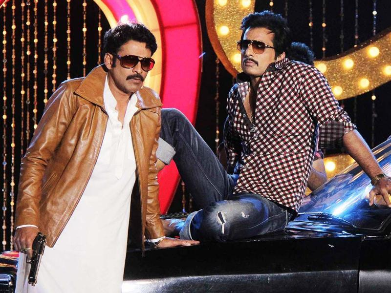 Manoj Bajpai and Sonu Sood perform during the music launch for Shootout At Wadala in Mumbai. (AFP Photo)