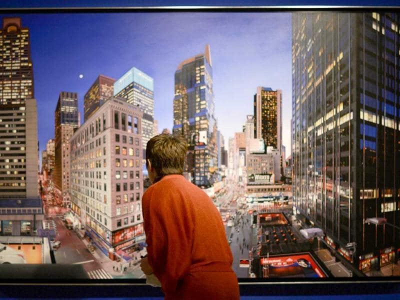 A woman looks at a painting by French artist Bertrand Meniel entitled 'The City That Never Sleeps' (2012) during the exhibition 'Hyperrealism 1967-2012' at the Thyssen-Bornemisza museum in Madrid. (AFP Photo/Pedro Armestre)