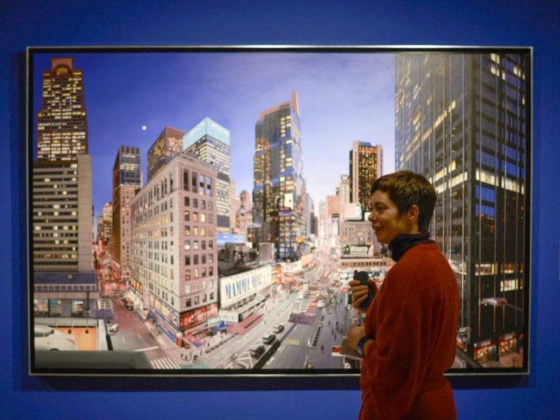 A woman stands in front of a painting by French artist Bertrand Meniel entitled 'The City That Never Sleeps' (2012) during the exhibition 'Hyperrealism 1967-2012' at the Thyssen-Bornemisza museum in Madrid on March 21, 2013. (AFP Photo/Pedro Armestre)