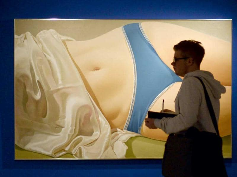 A man stands in front of a painting by American artist John Kacere entitled 'Serina '72' (1972) during the exhibition 'Hyperrealism 1967-2012' at the Thyssen-Bornemisza museum in Madrid. (AFP Photo/Pedro Armestre)