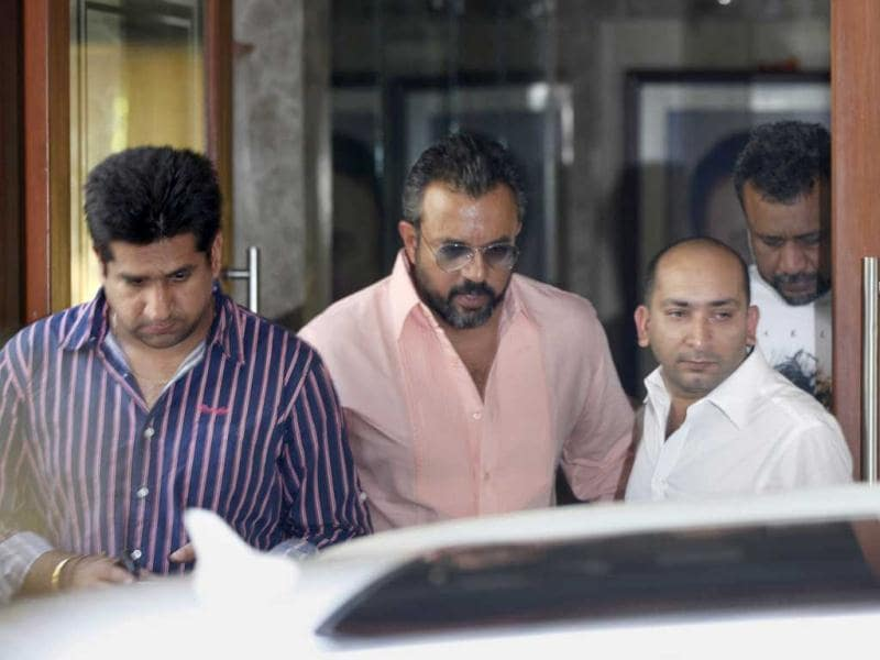Bollywood film director Apoorva Lakhia, leaves bollywood actor Sanjay Dutt's residence in Mumbai after Supreme Court's verdict upholding his sentence. (HT Photo/Satish Bate)