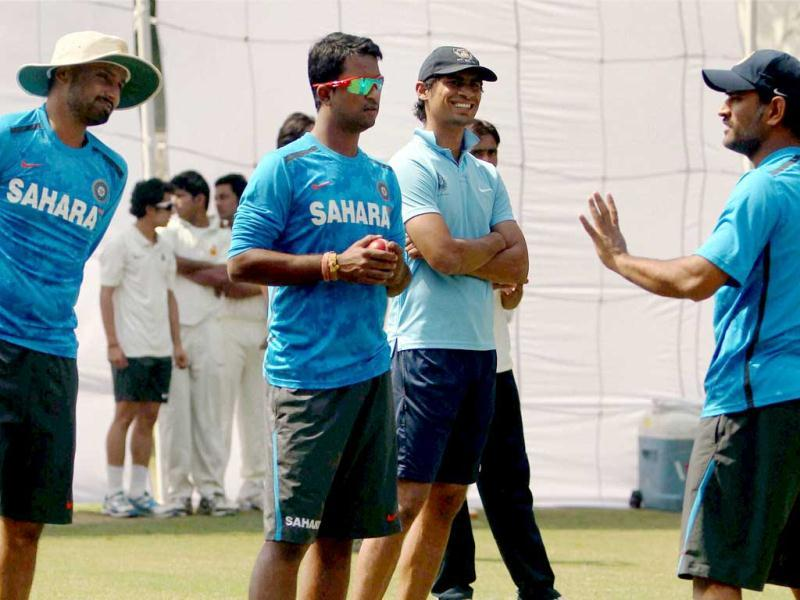 MS Dhoni with other players during a practice session for 4th test match against Australia at Feroz Shah Kotla stadium in New Delhi. PTI Photo