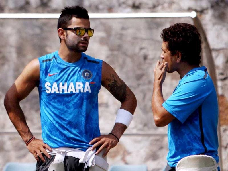 Sachin Tendulkar and Virat Kohli during a practice session for 4th test match against Australia in New Delhi. PTI