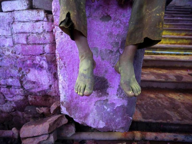 The coloured feet of a devotee are pictured outside a temple during Lathmar Holi at the village of Barsana in Uttar Pradesh. (Reuters)