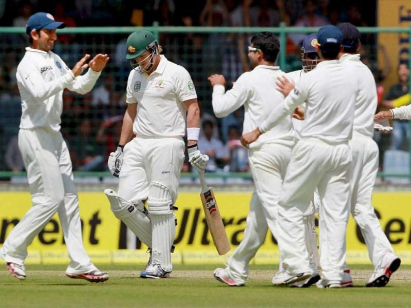 Indian players celebrate the wicket of Australia's Shane Watson on the 1st day of the 4th cricket Test match at Feroz Shah Kotla stadium in New Delhi. PTI photo