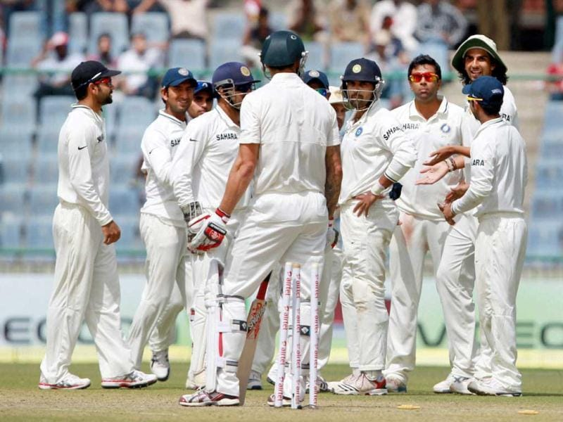 Indian players celebrate dismissal of Australia's M Johnson on the 1st day of the 4th cricket Test match at Feroz Shah Kotla stadium in New Delhi. PTI photo