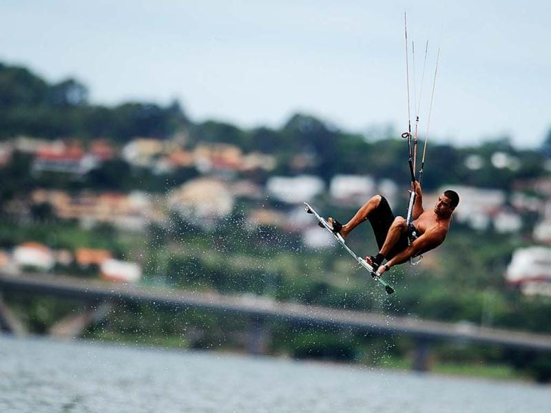 A man practices kitesurf at Paranoa Lake, in Brasilia. (AFP)